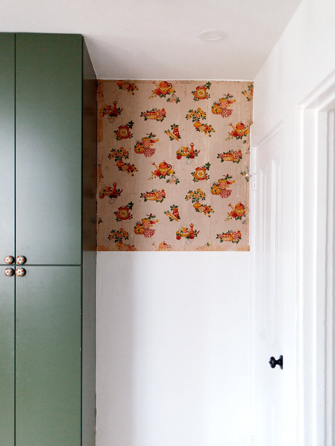 orange wallpaper near the top of the wall