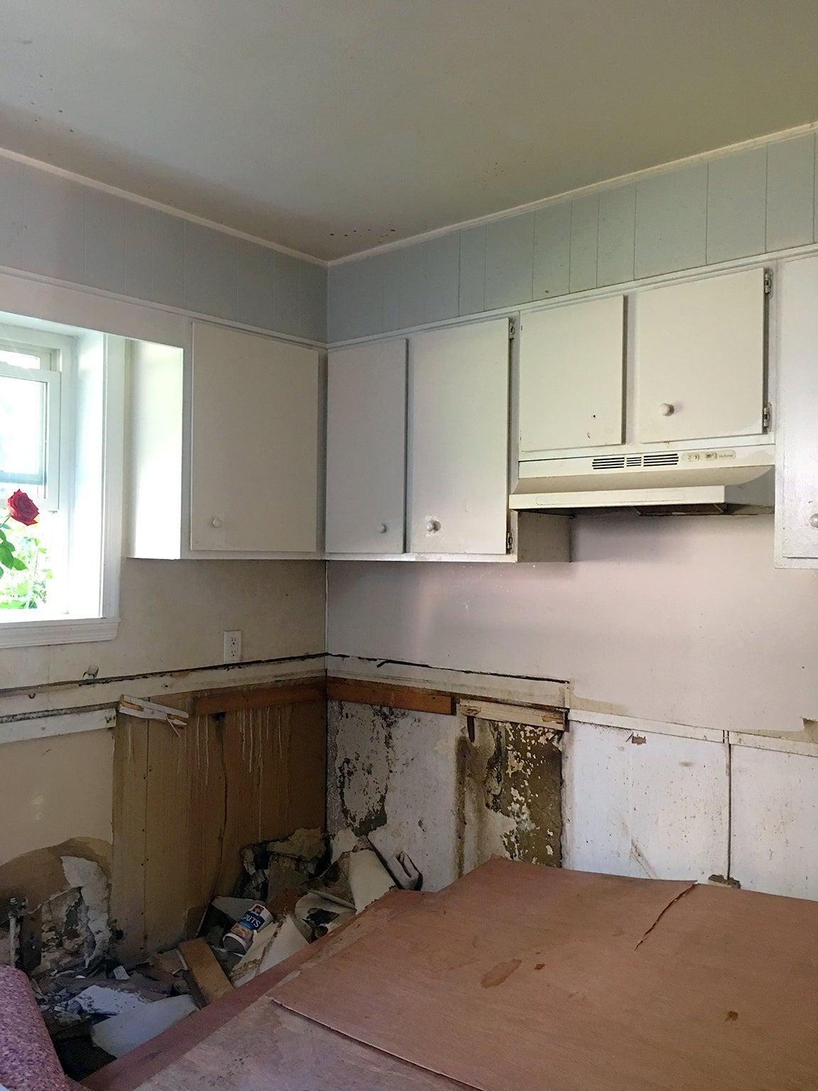 before image of half demolished kitchen