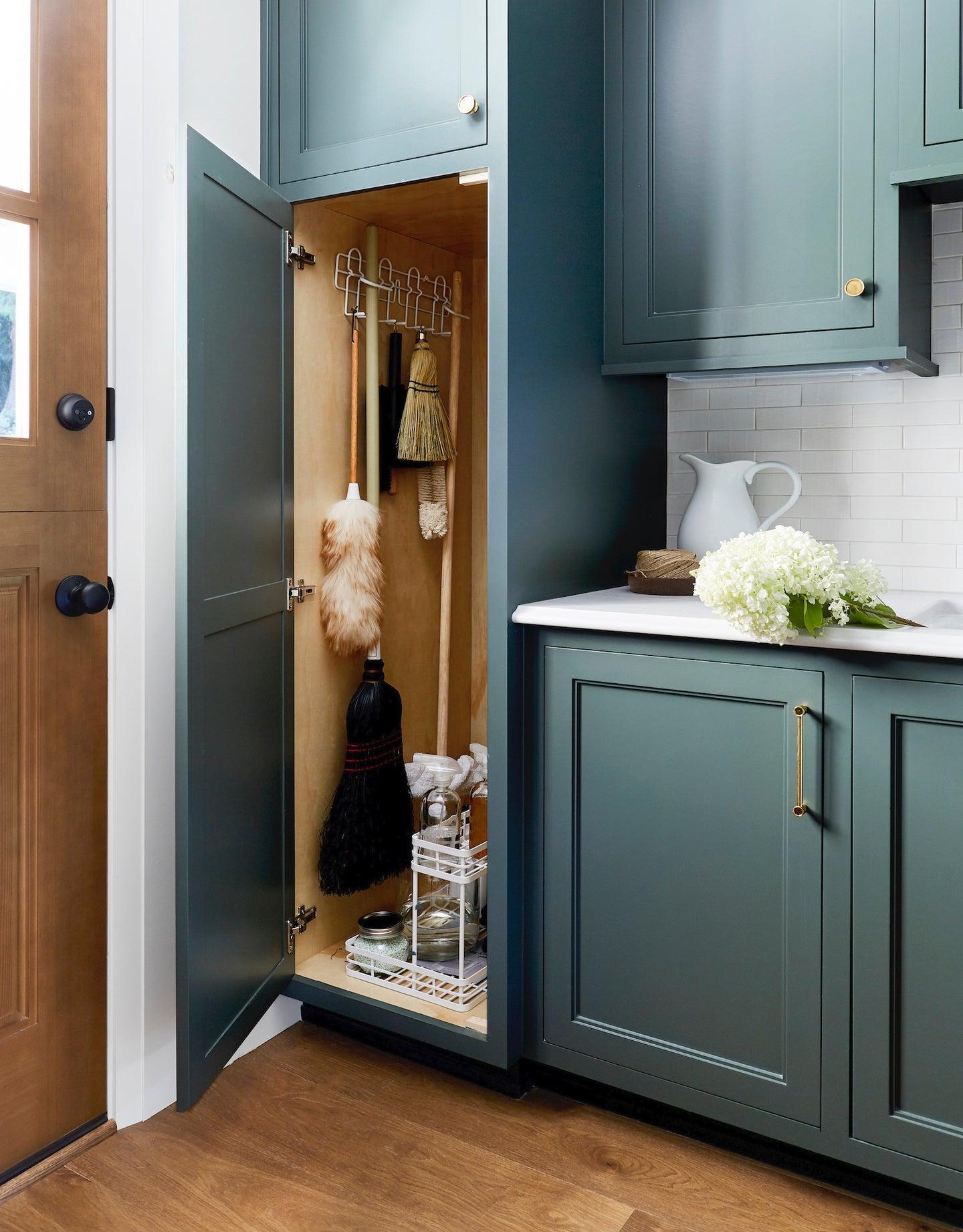 dark green cleaning supplies cabinet