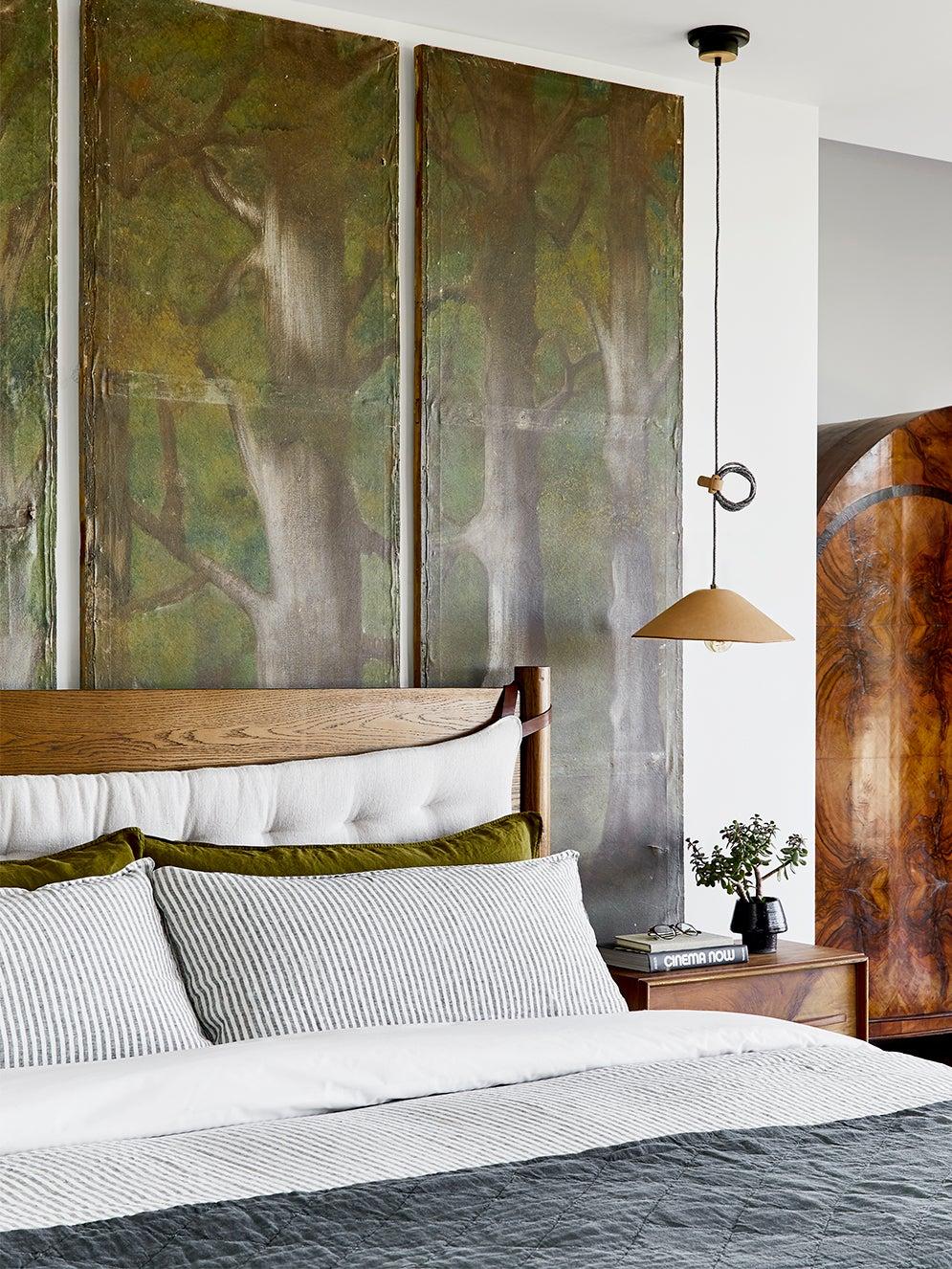 Bedroom with green headboard
