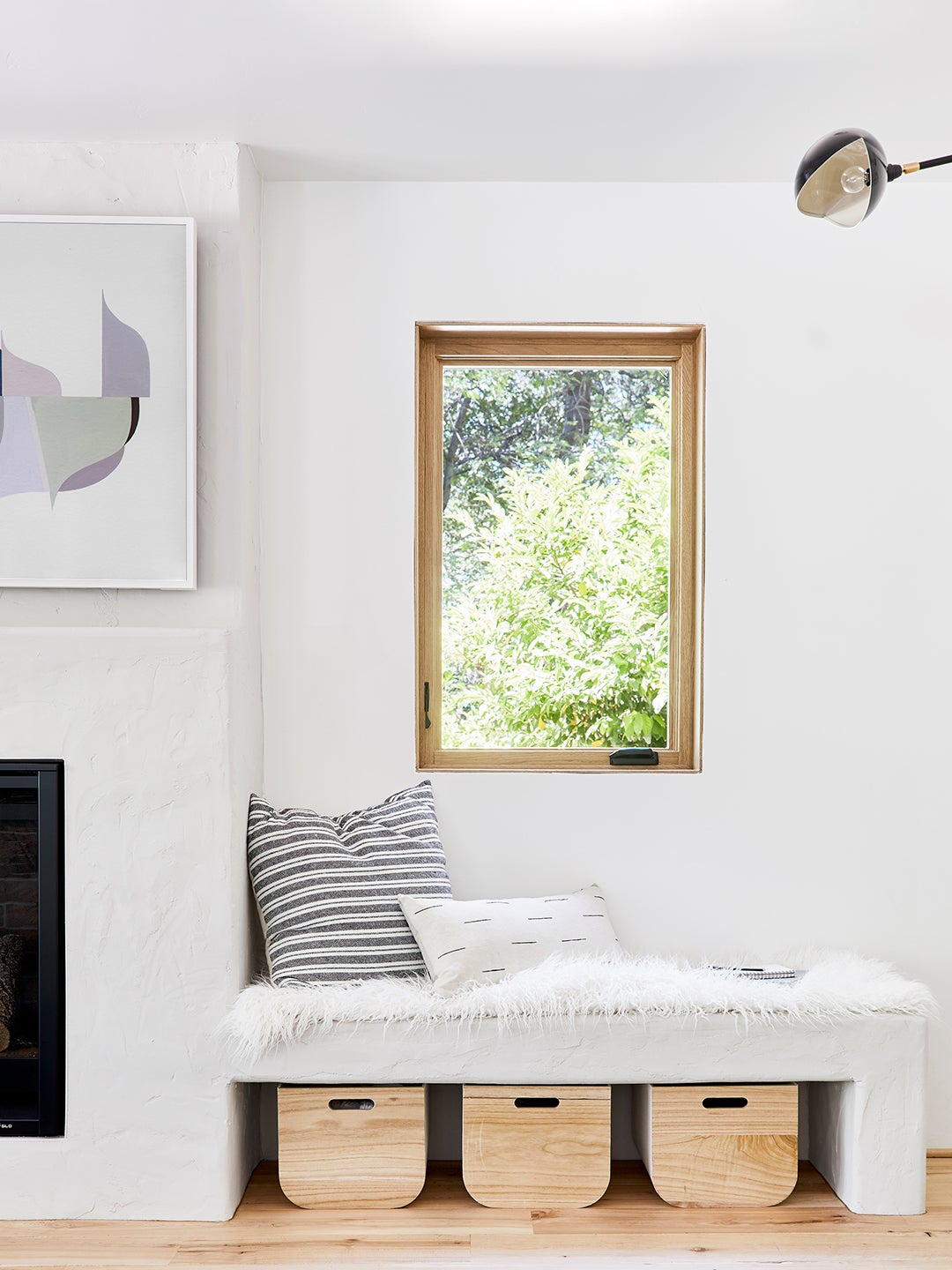 white room with reading nook under window