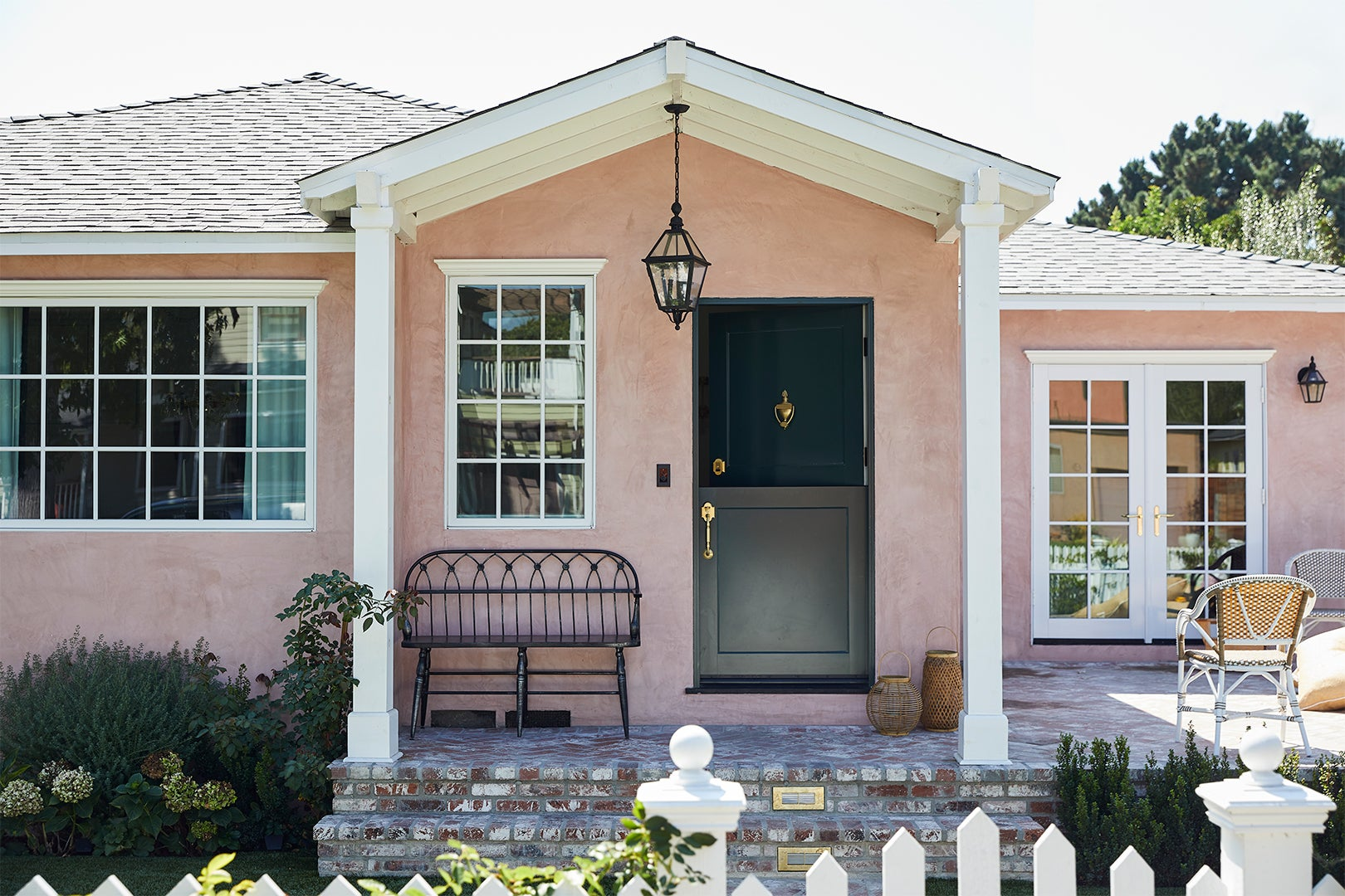 little pink house with bench on front porch