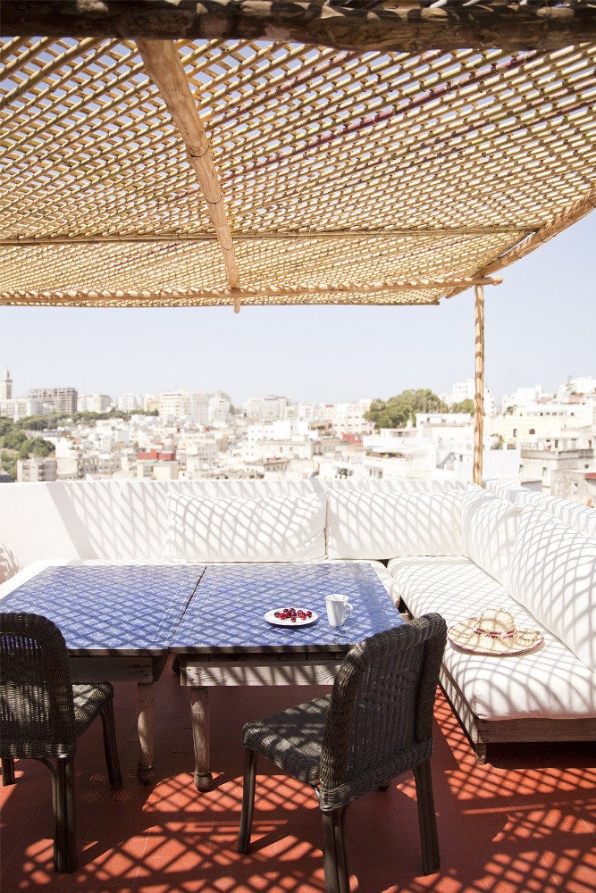moroccan patio with blue table