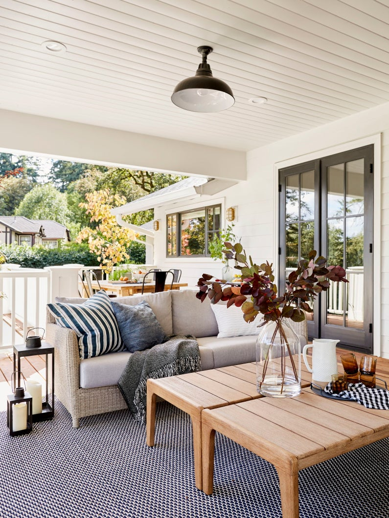 outdoor porch with living room sofa and coffee table