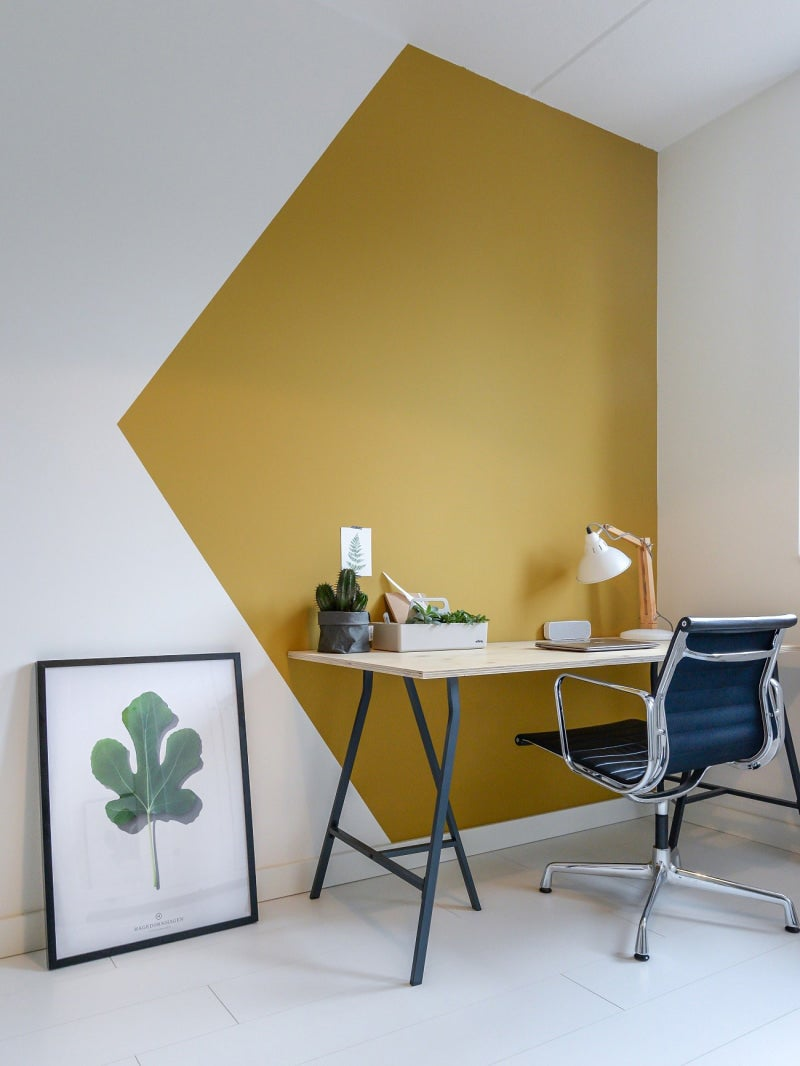 Yellow corner colorblocked wall in a home office