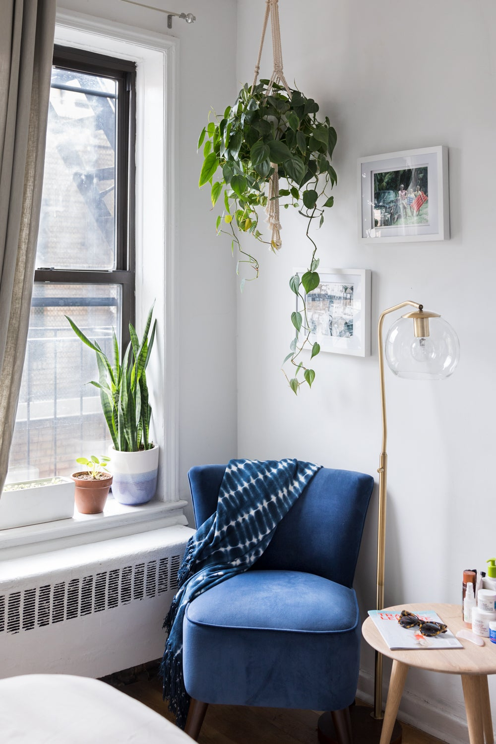 Corner of a room with a chair and a plant