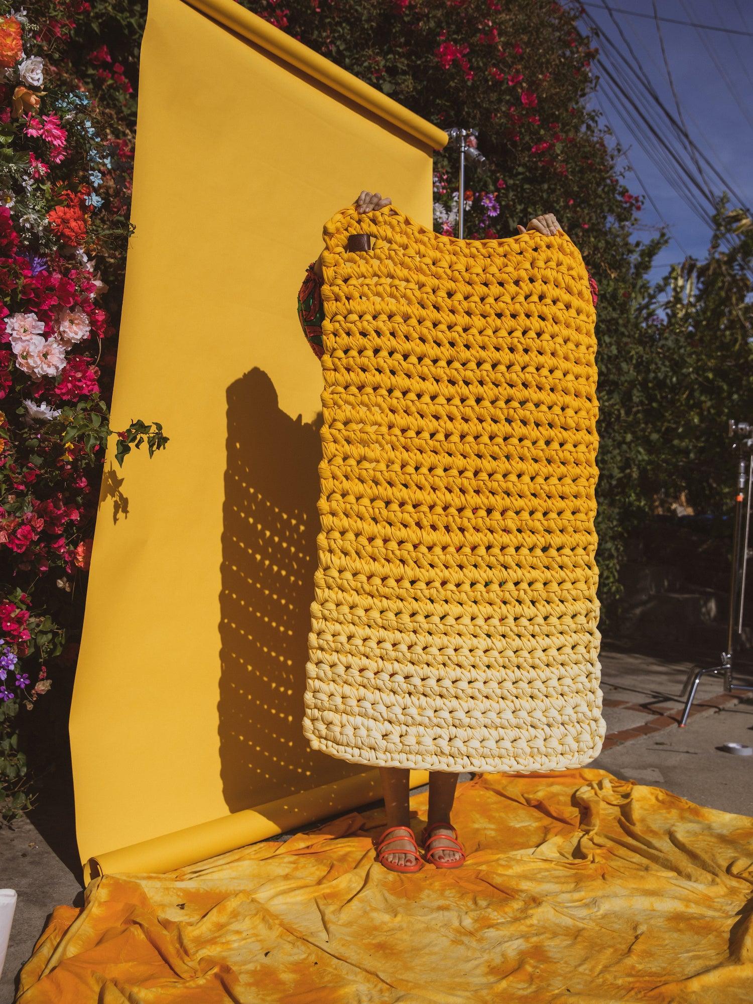 woman holding yellow blanket