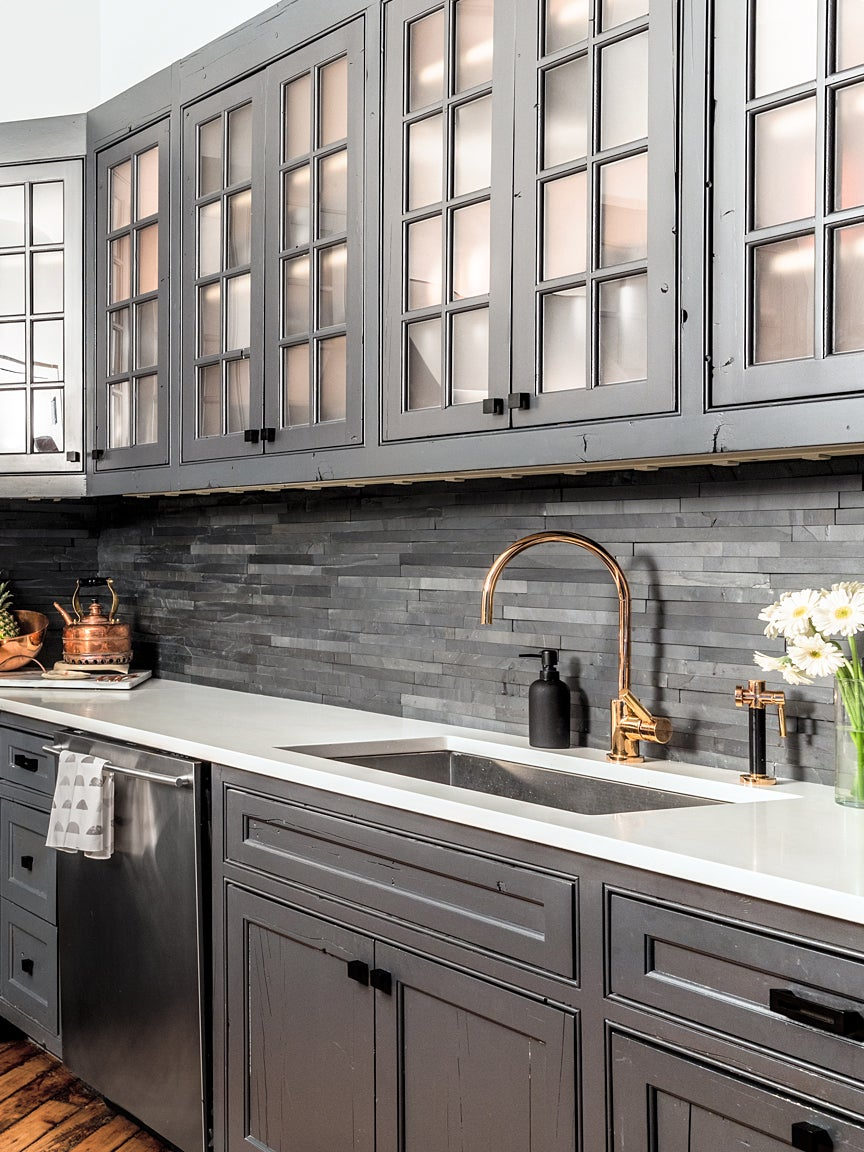 gray kitchen with copper faucet
