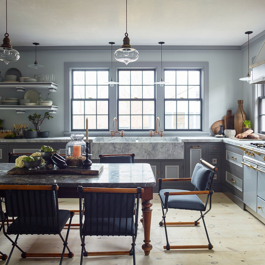 Blue kitchen with marble counters