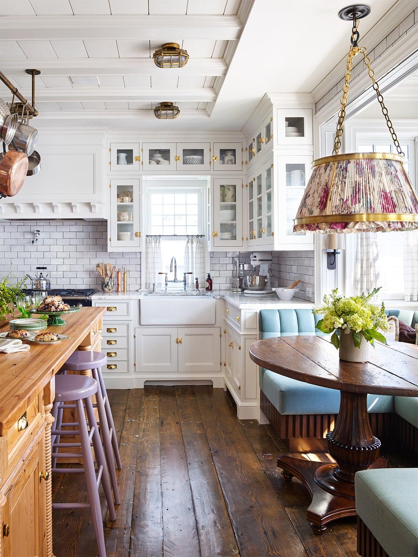 White kitchen with blue breakfast banquette