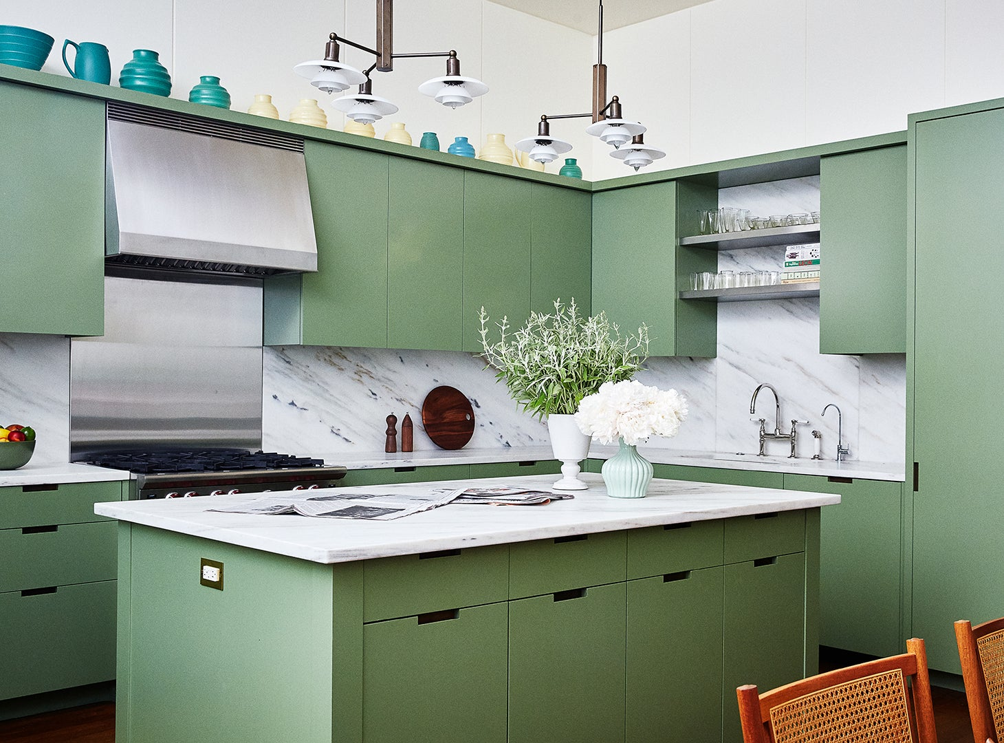 Green kitchen with white marble countertops