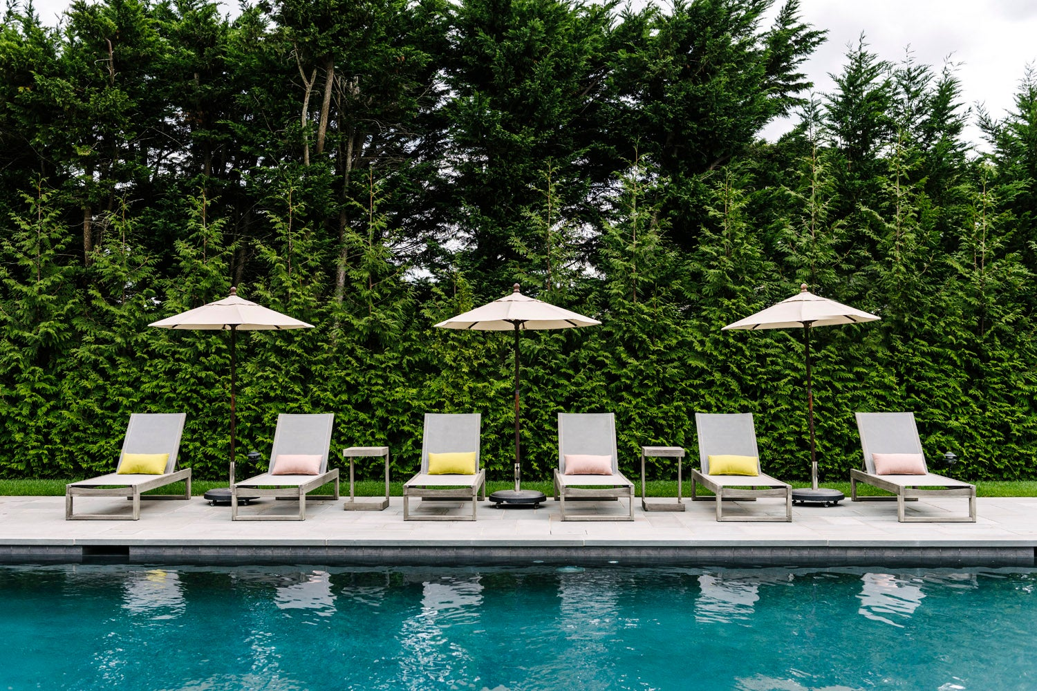 pool with chairs and umbrellas