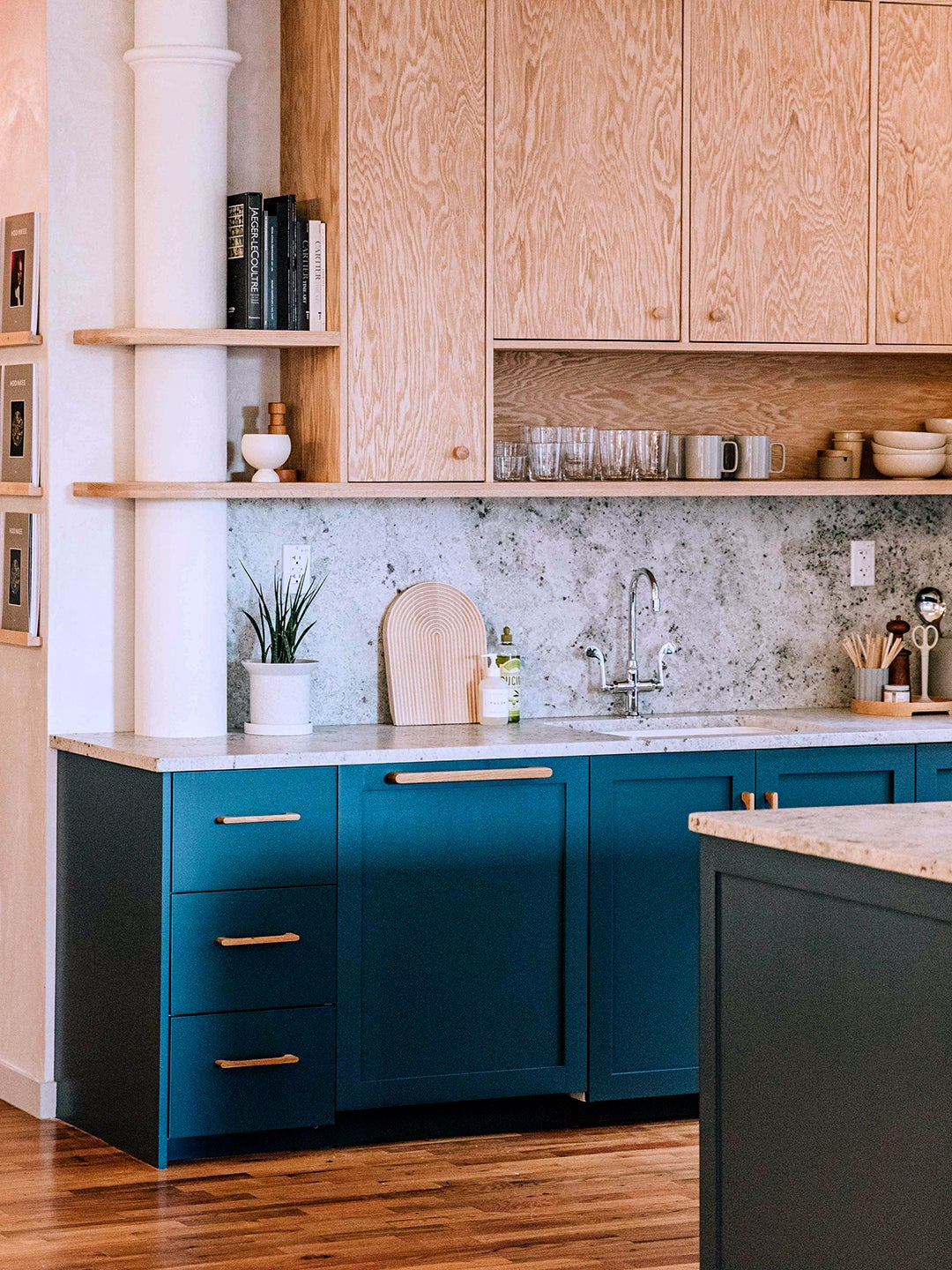 Kitchen with built in shelf and column