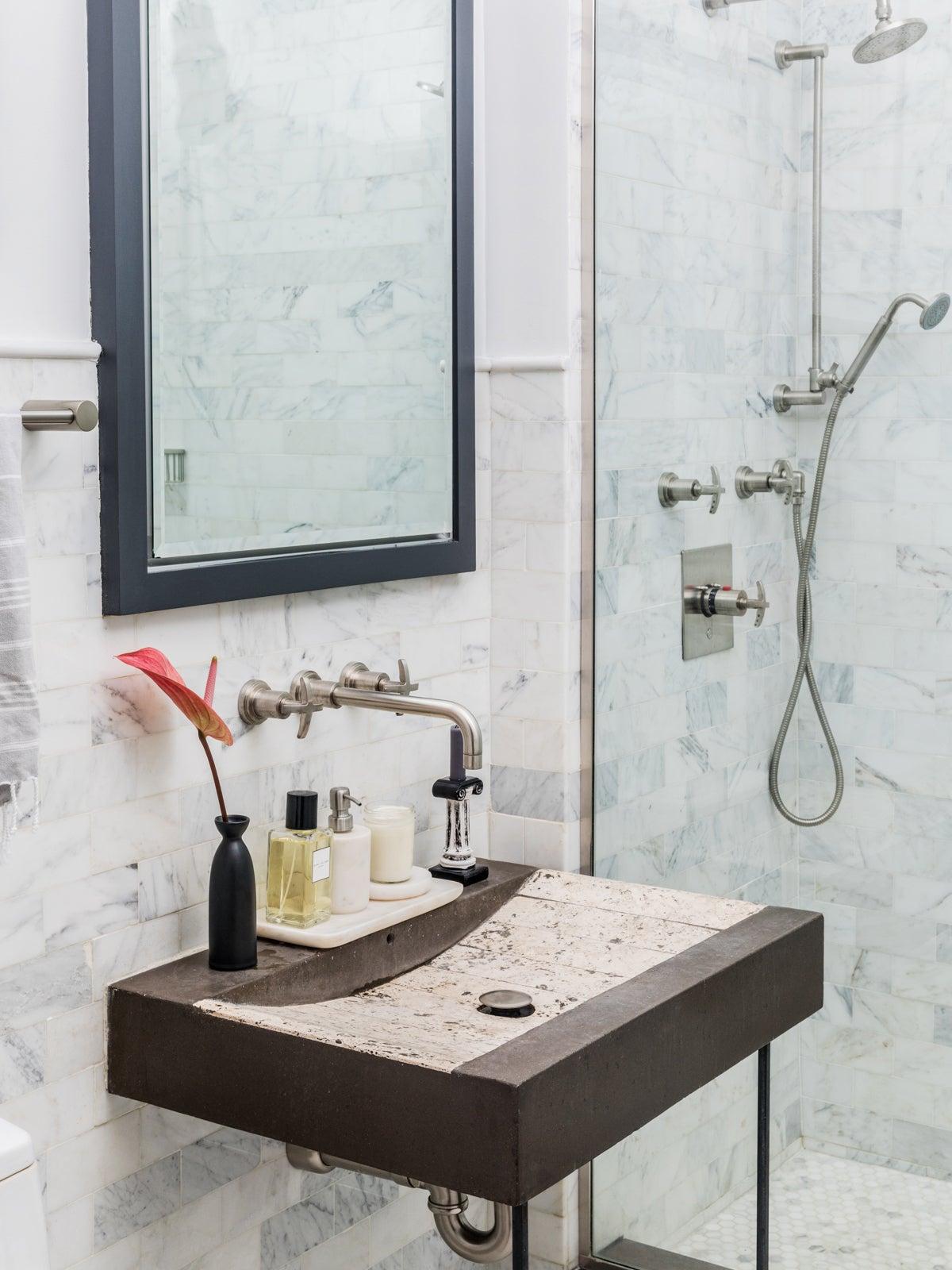 Simple bathroom sink with anthurium in vase