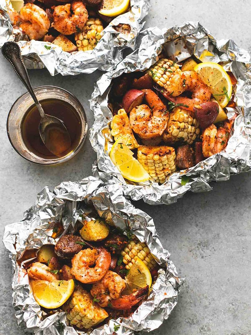 seafood bakes in aluminum with corn