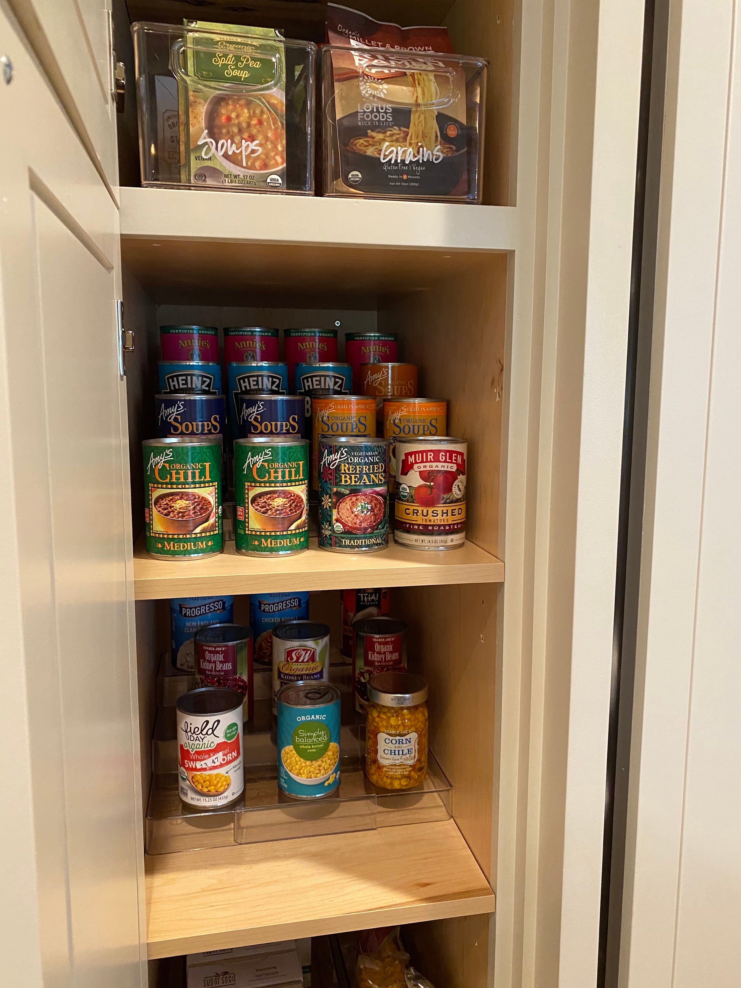 pantry shelves with cans stacked