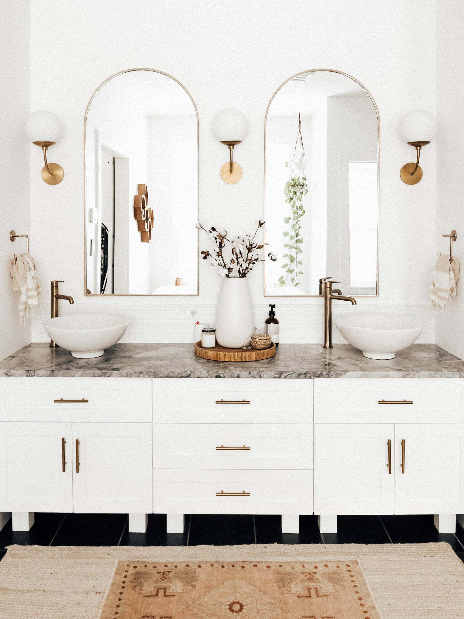 white bathroom vanity with gray counters