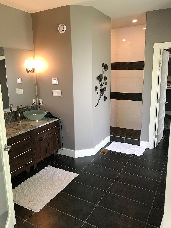 black stone bathroom floors and gray walls