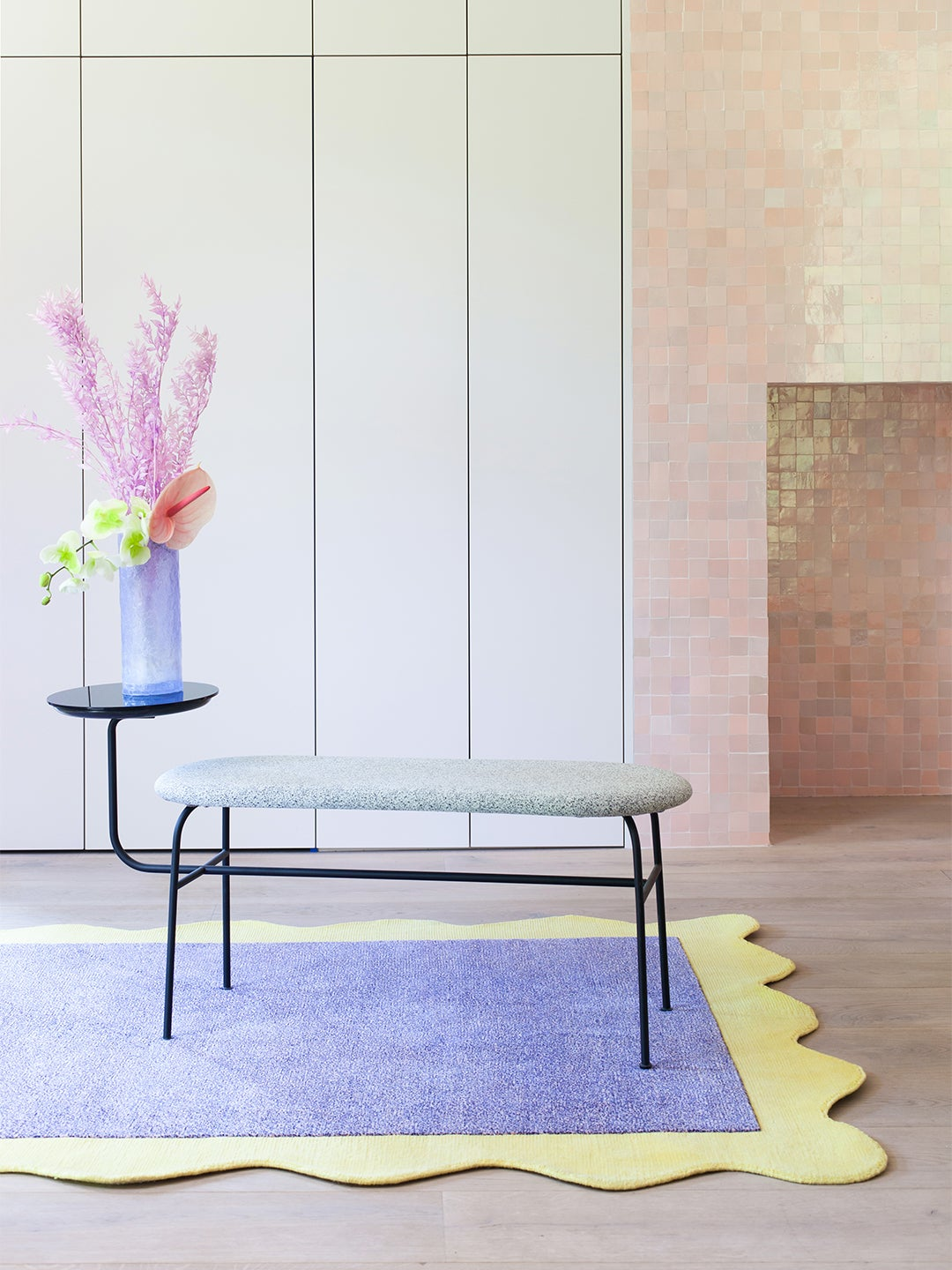 pink room with lilac and neon yellow rug