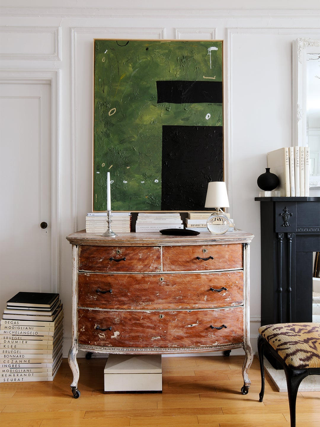 Green painting above a dresser