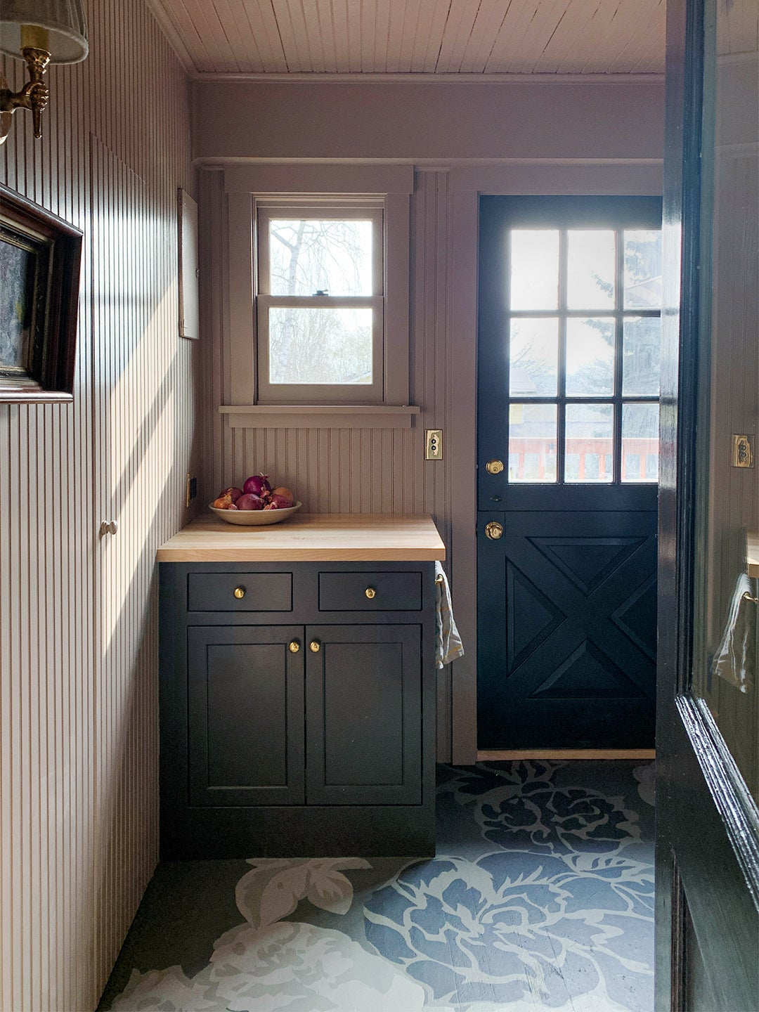 black cabinet with pink walls
