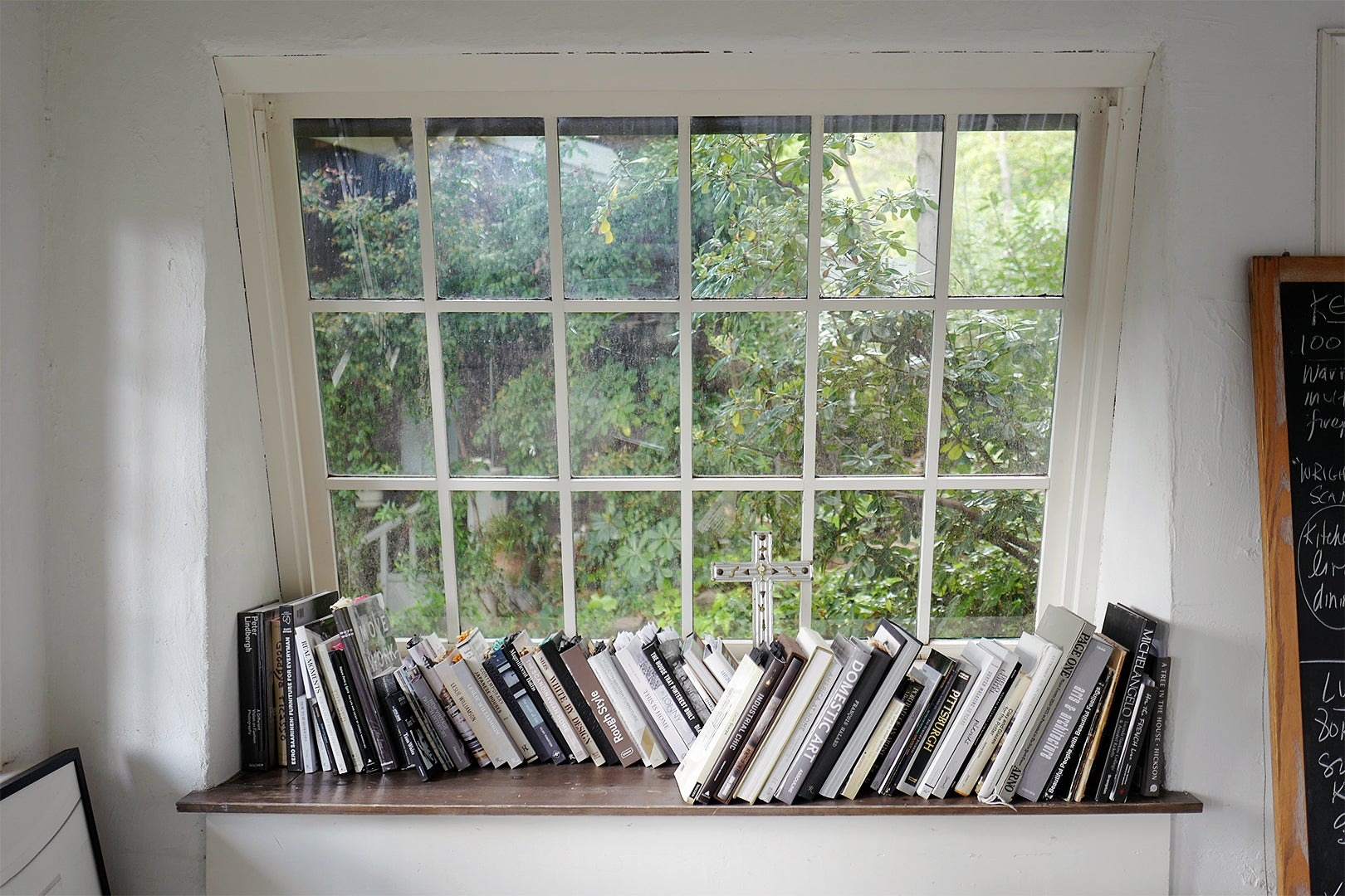books stacked in window nook