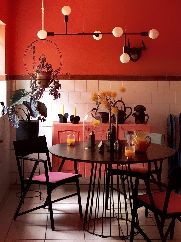 red kitchen with mid century chandelier