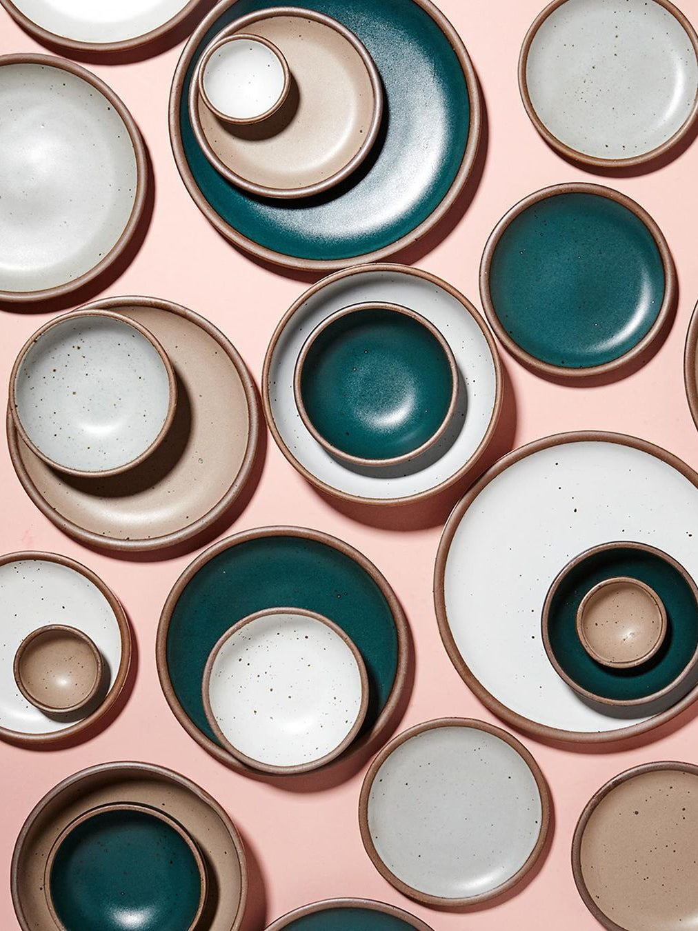 Assorted colorful East Fork pottery
