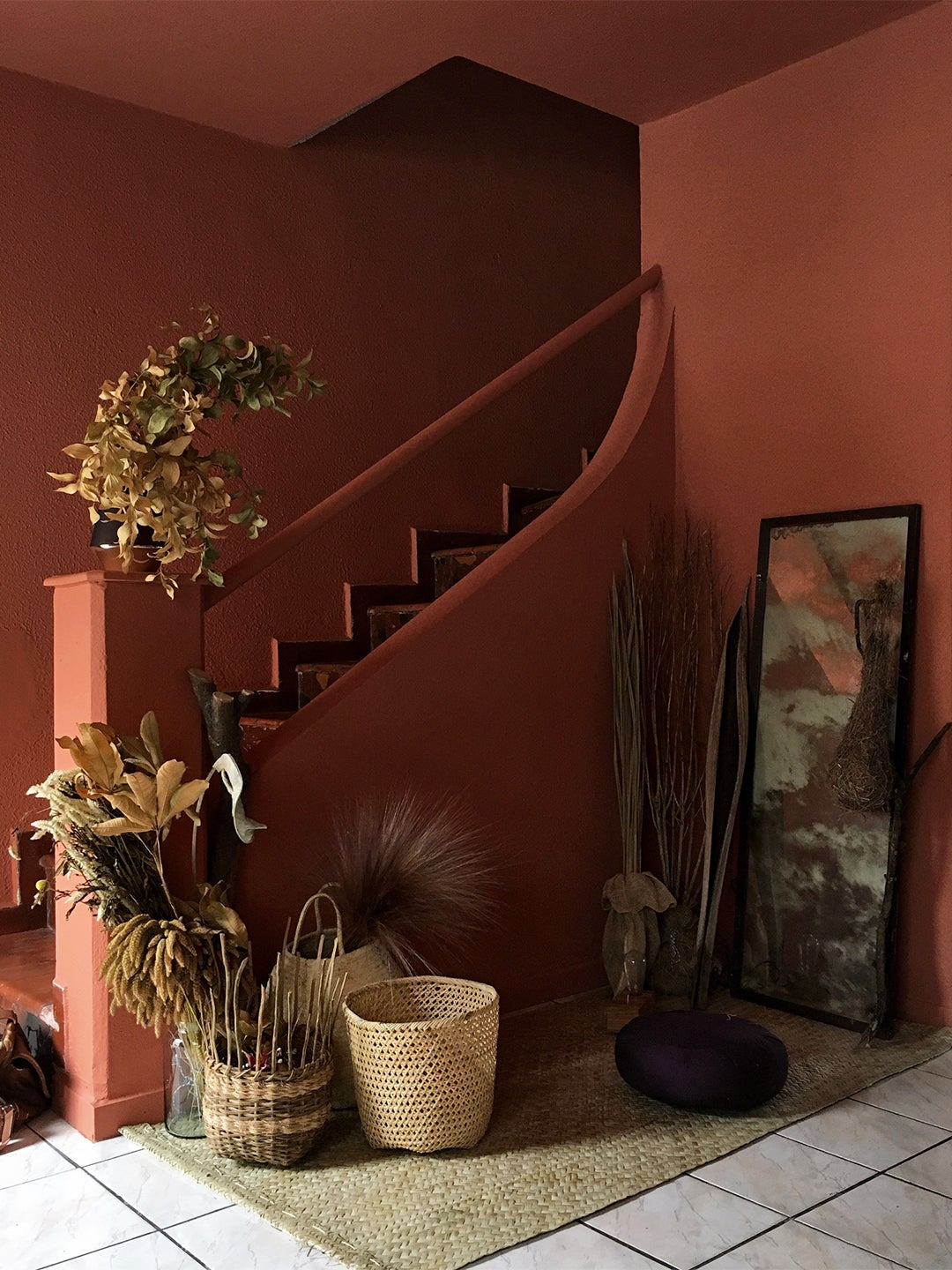 terra cotta colored entryway with staircase