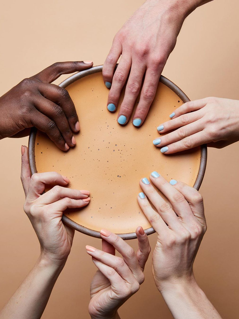 Hands holding East Fork plate