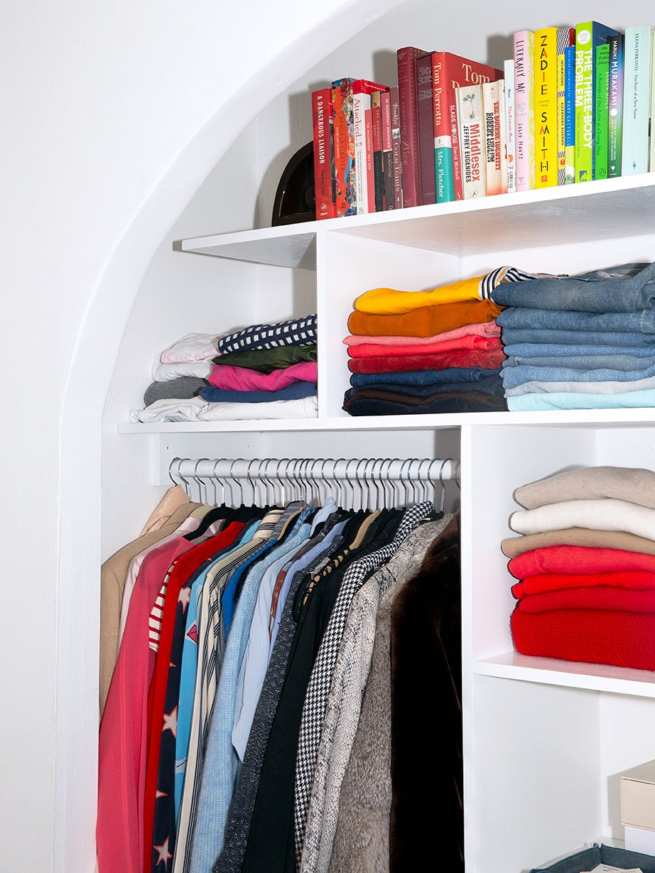 open closet with white archway