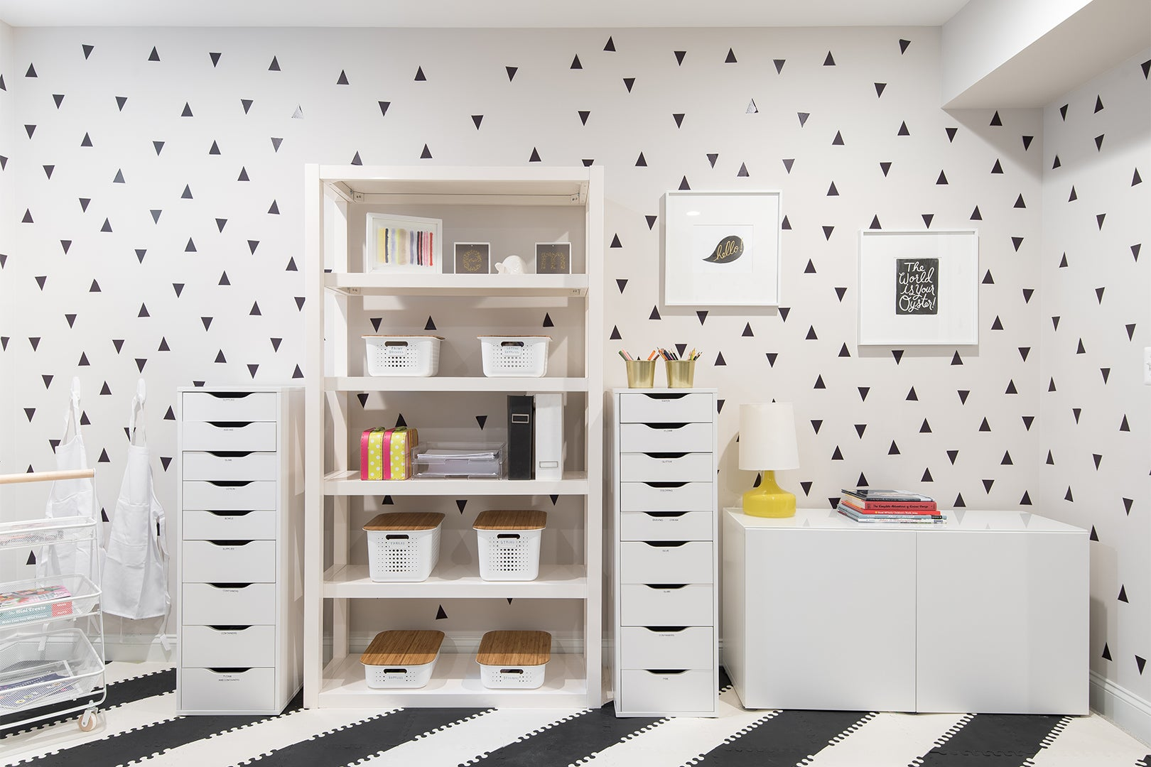 black and white wallpaper and shelves fro kids crafts