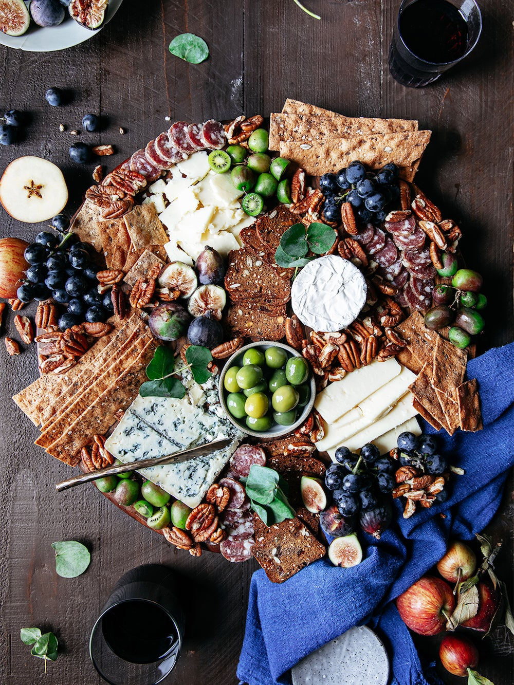 cheeseboard with olives and salami