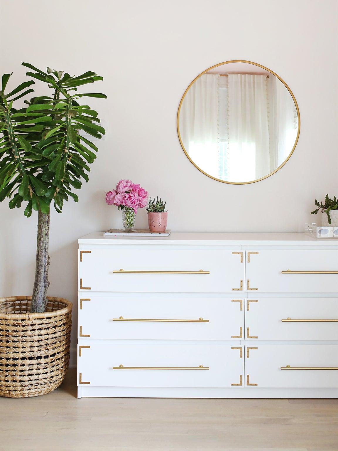 white dresser with brass detailing