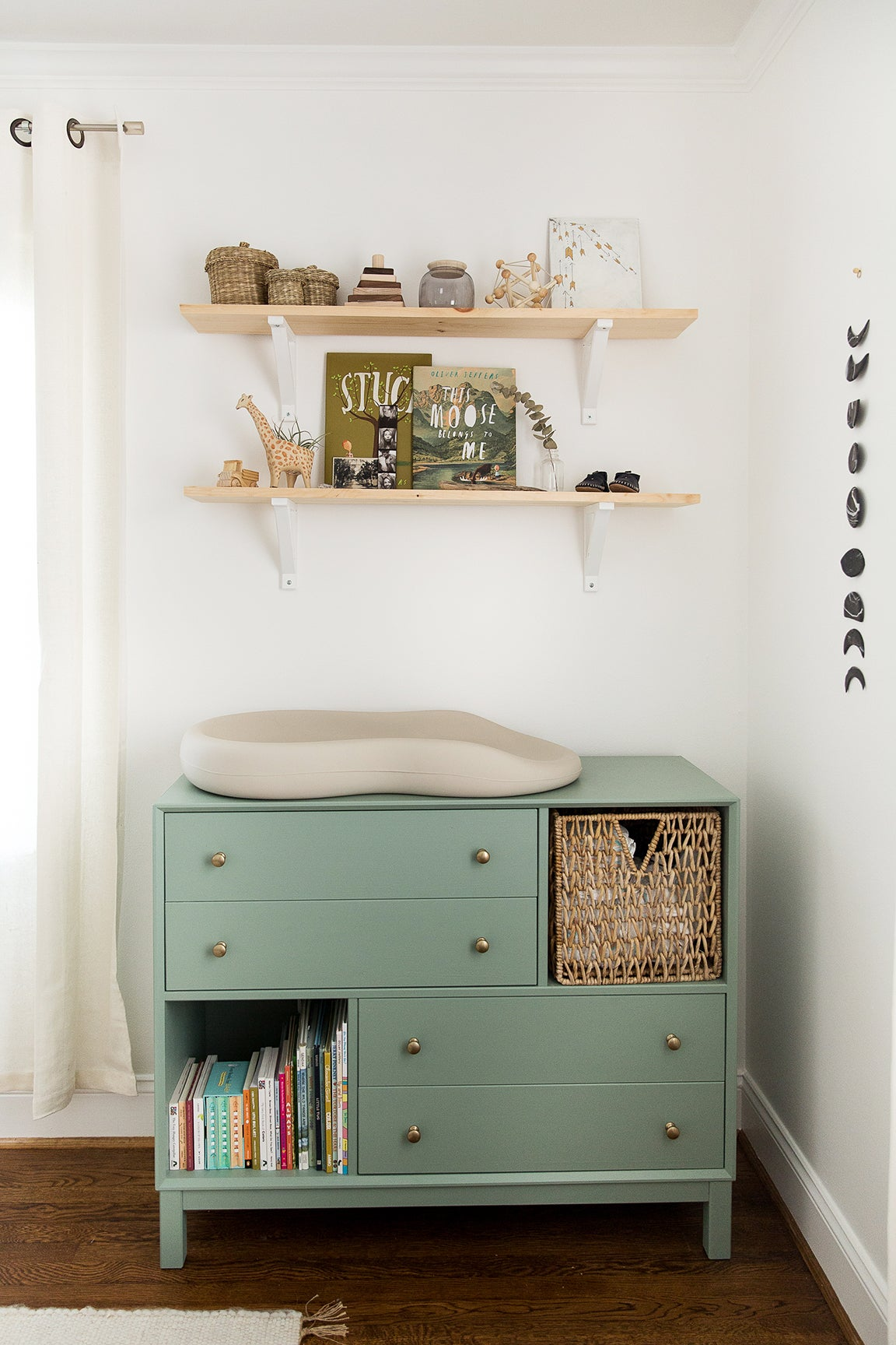 green changing table with cubbies