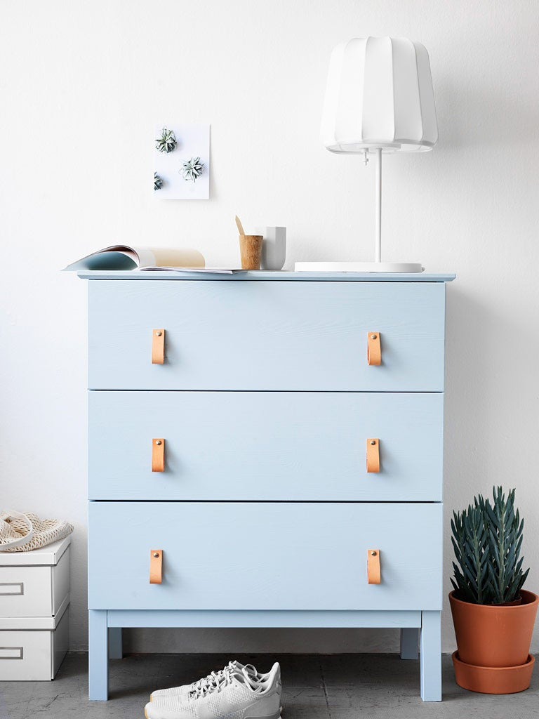 blue dresser with leather pulls