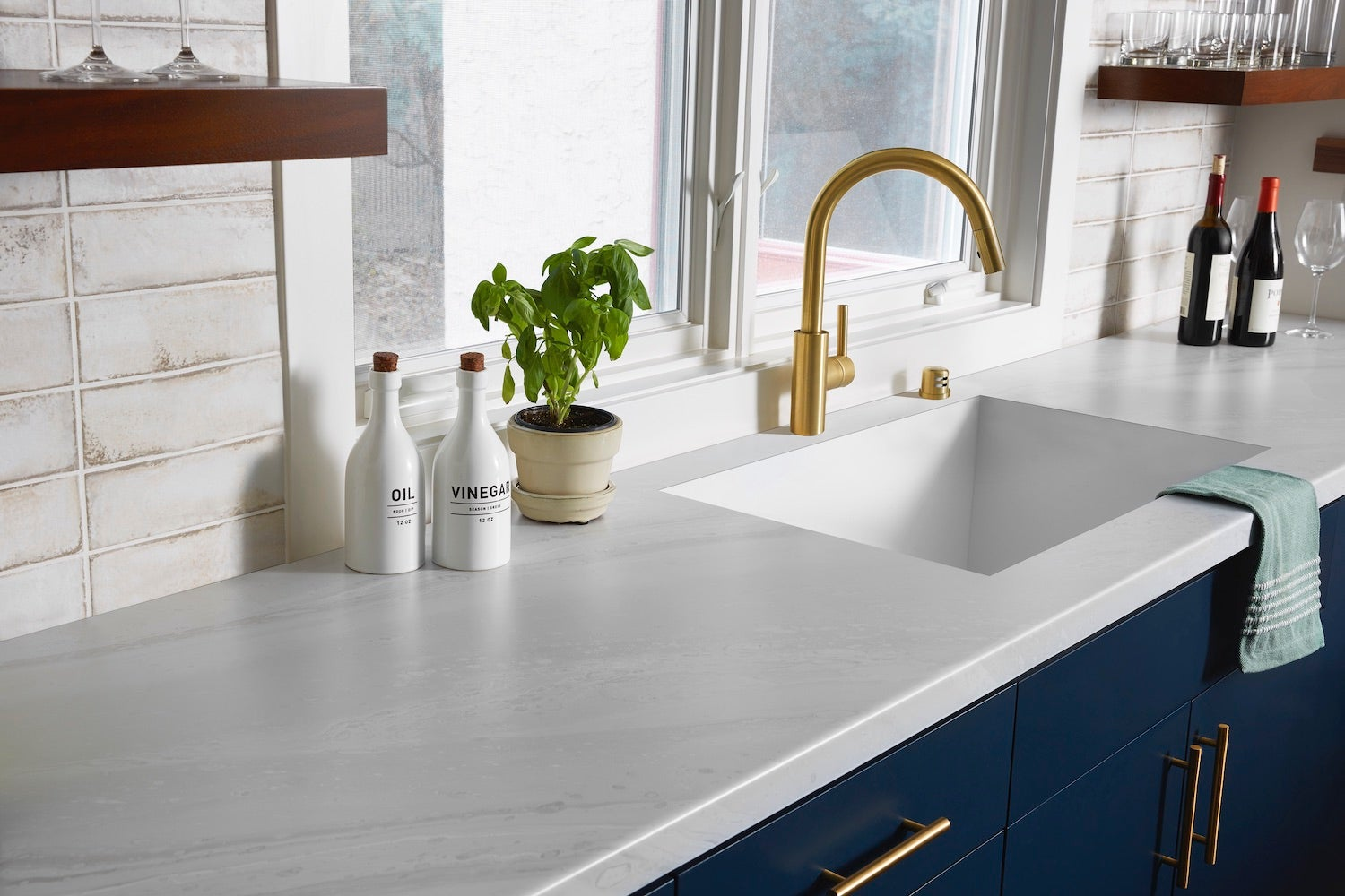 white counter with blue cabinets