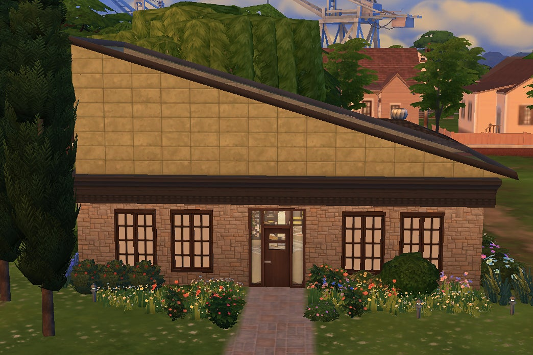 Exterior of green Sims home