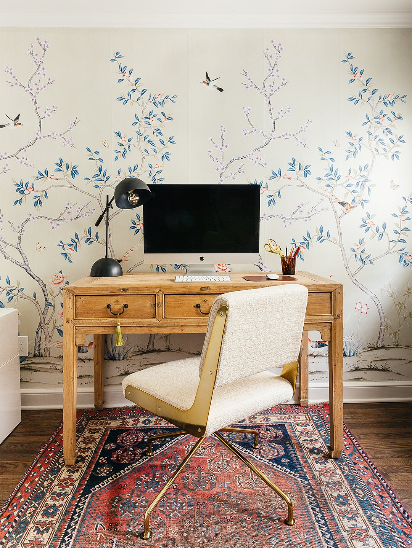 wood desk and floral wallpaper