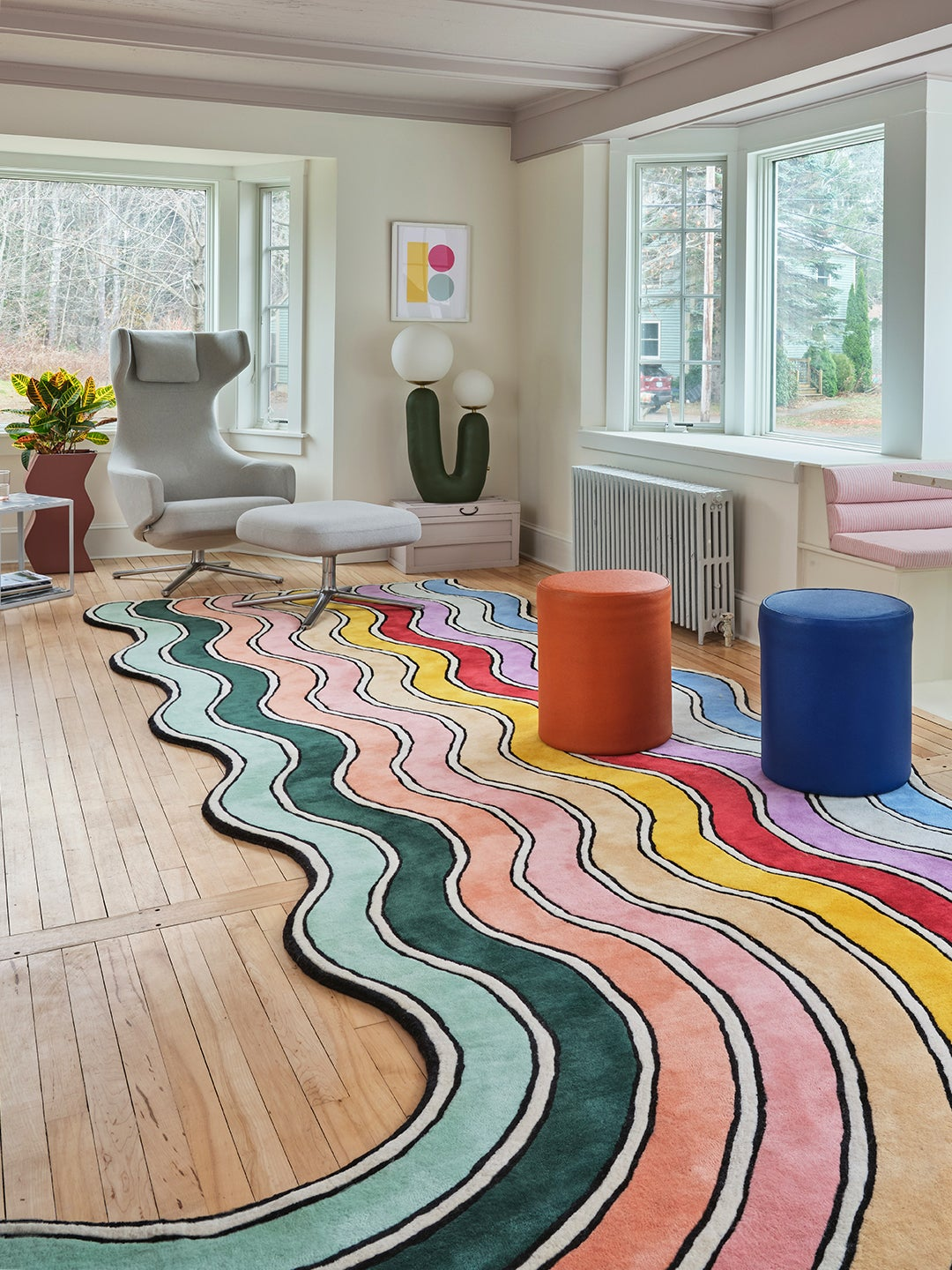 rainbow rug and colorful stools