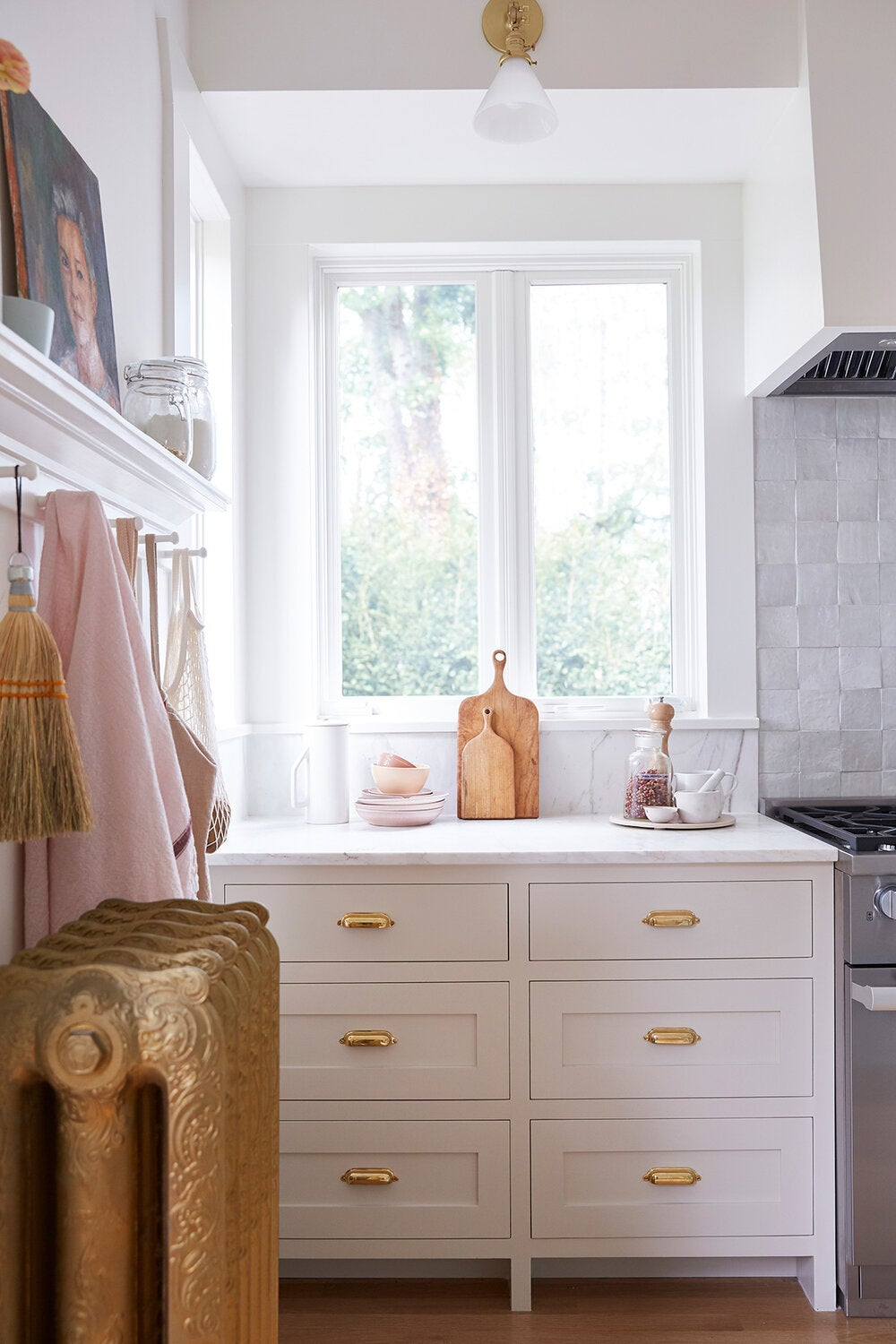 white kitchen cabinets with antique gold radiator