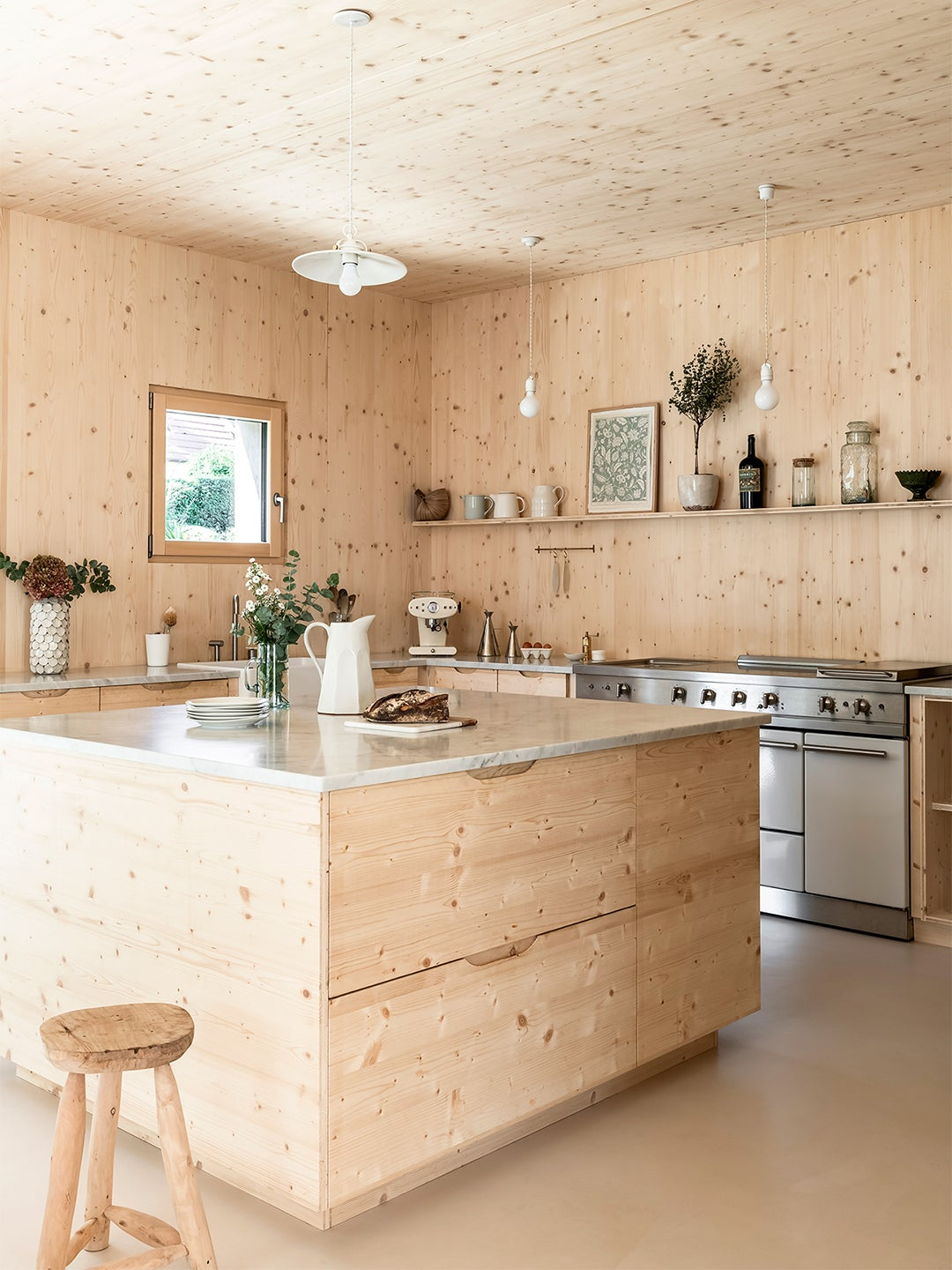 wood kitchen with cream resin floors