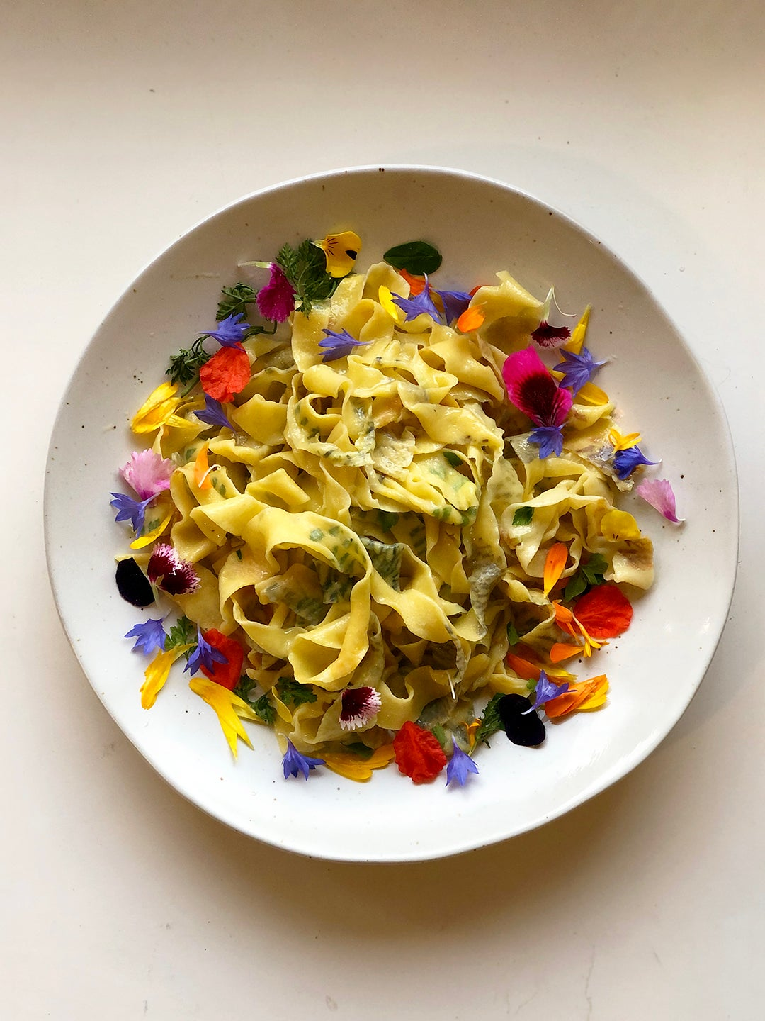 bowl of pasta with flowers