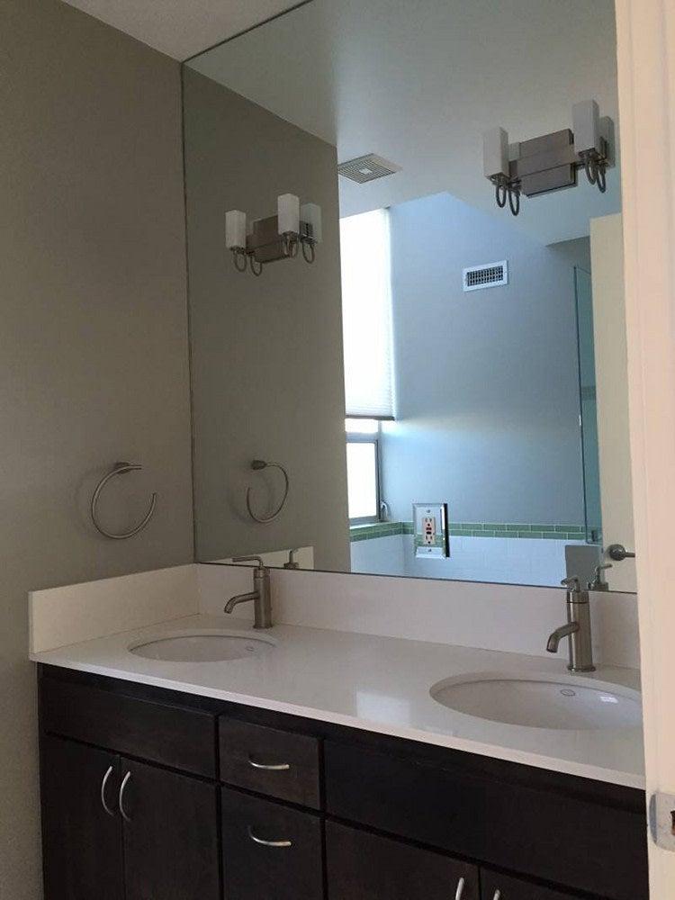 Before - dim bathroom with dark console