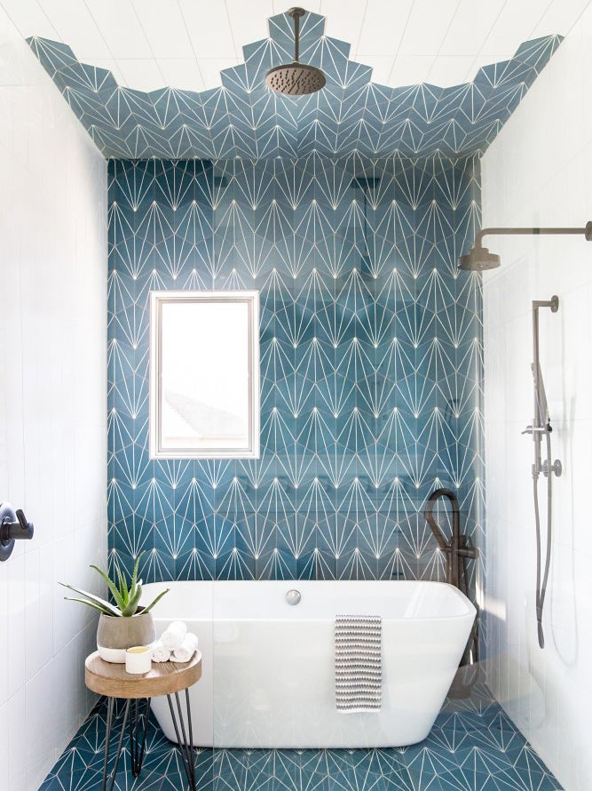 Bathroom with tub and blue tile