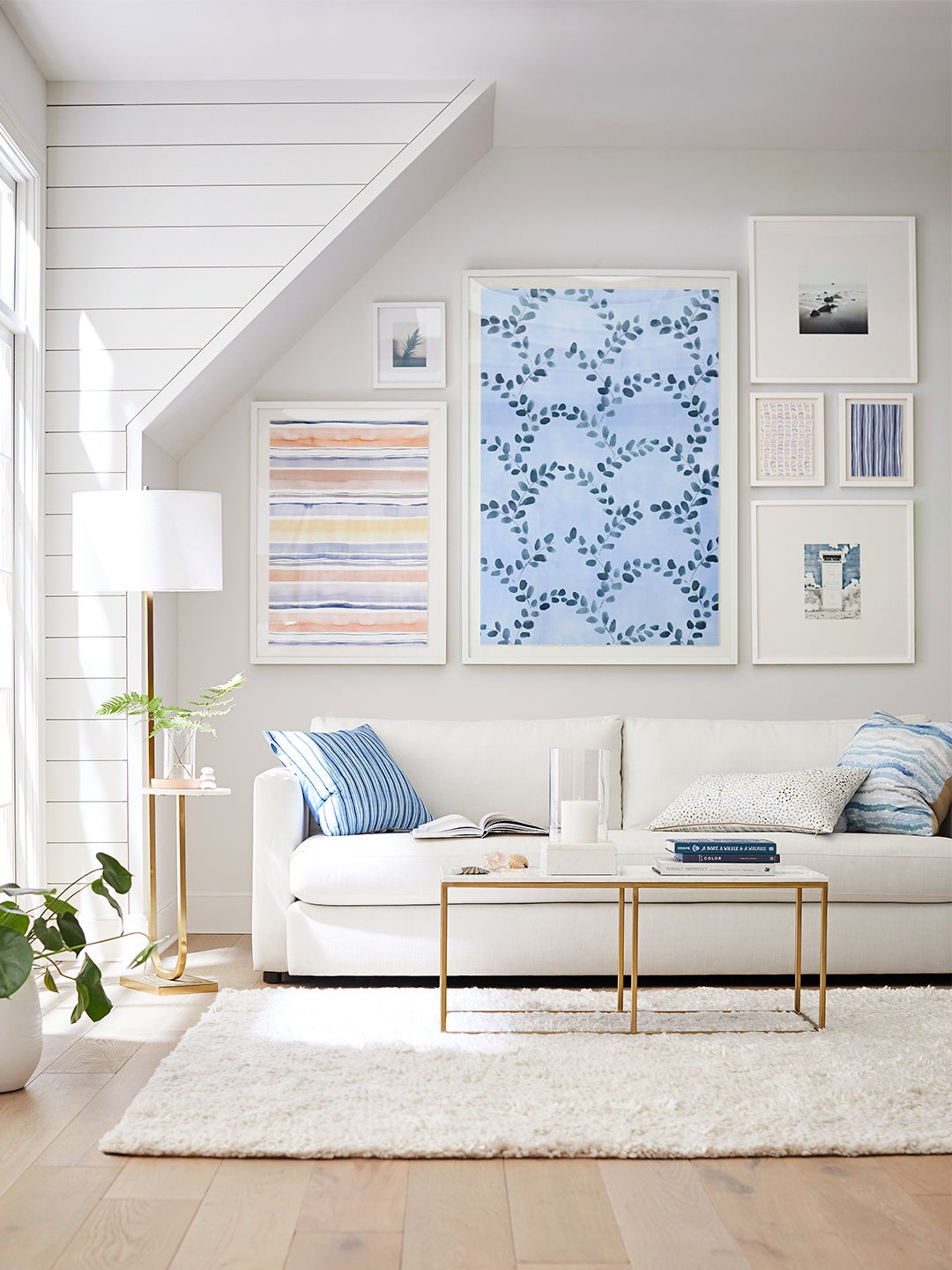 living room with Rebecca Atwood prints on wall