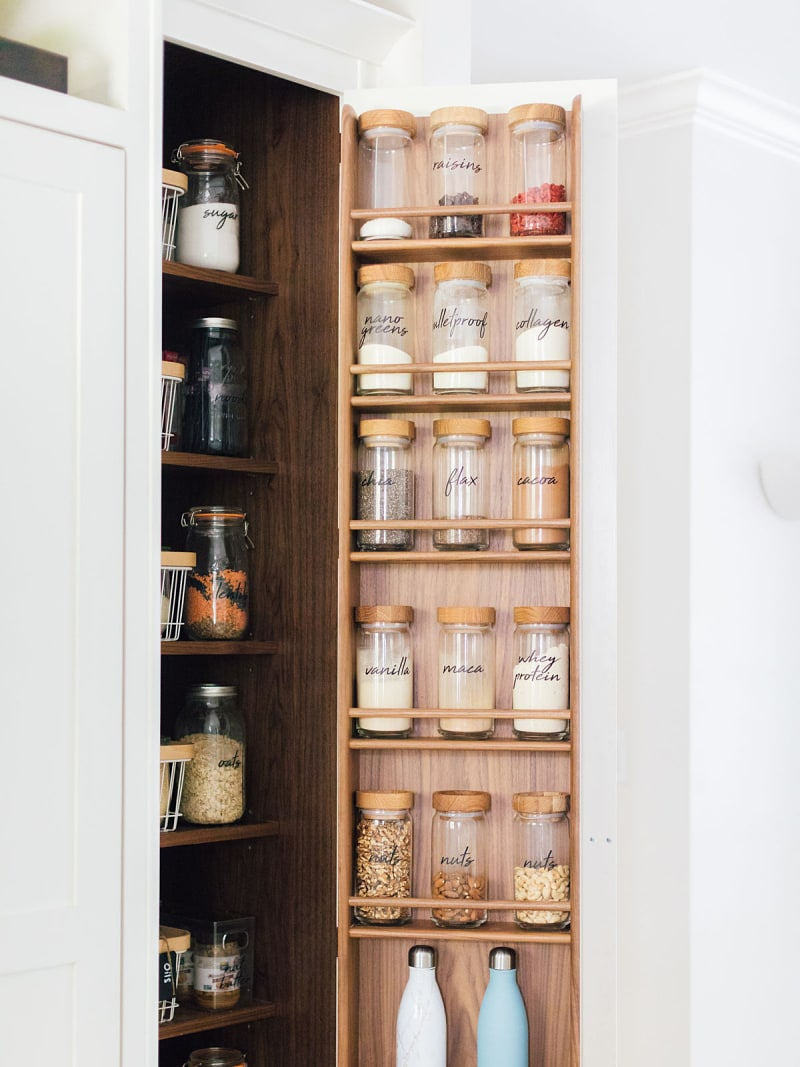 pantry door lined with spice jars
