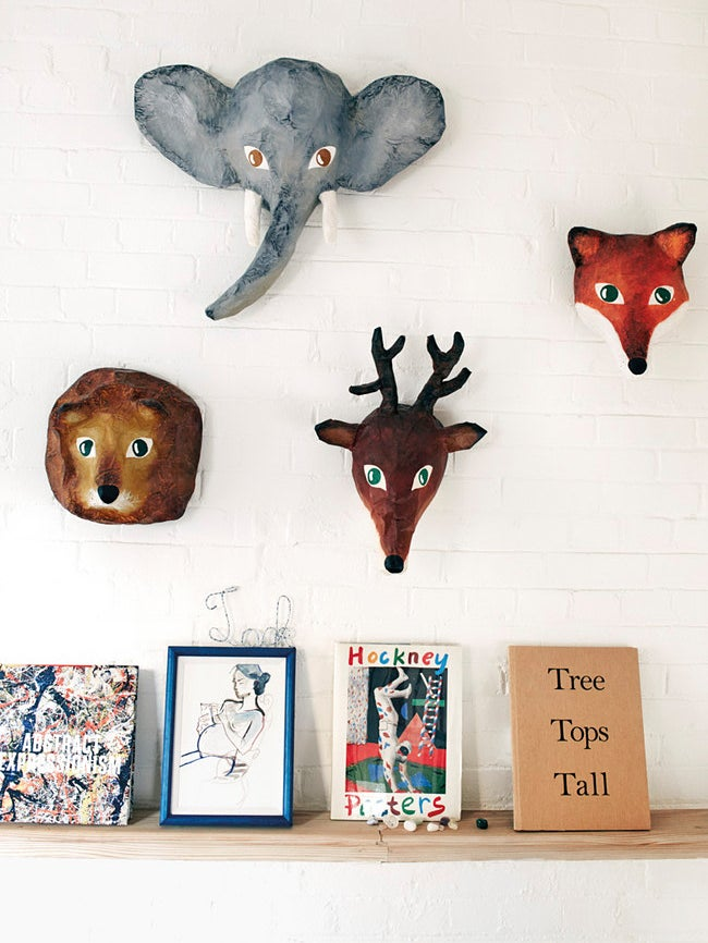 menagerie heads on a wall with books