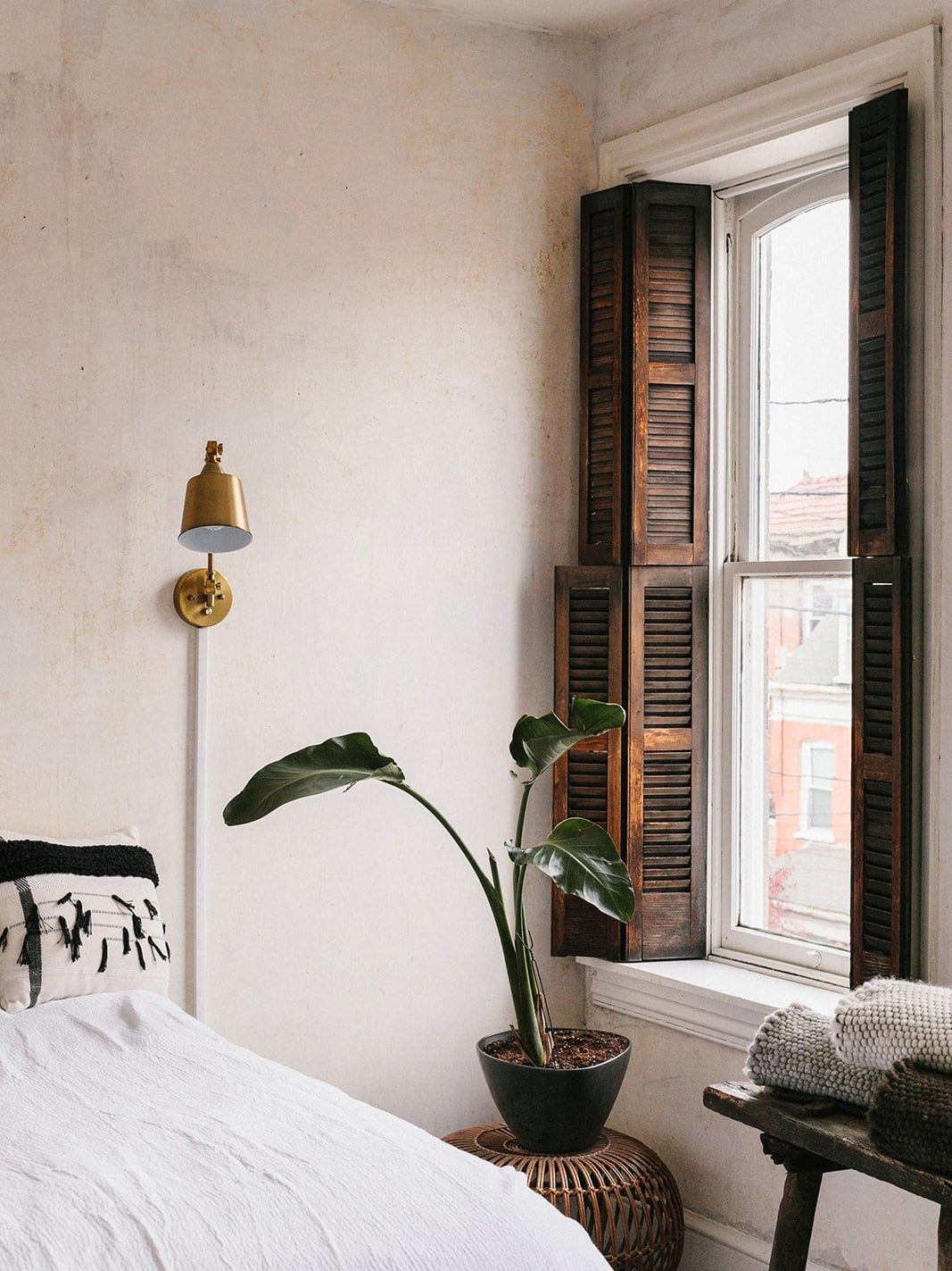 old wood shutters in a white bedroom