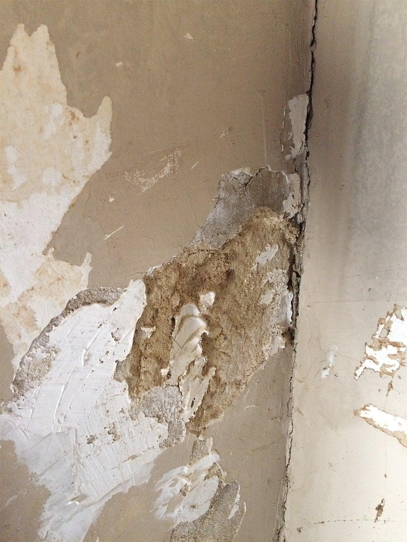 damaged tan plaster wall